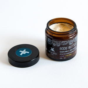 body butter in amber glass pot without lid