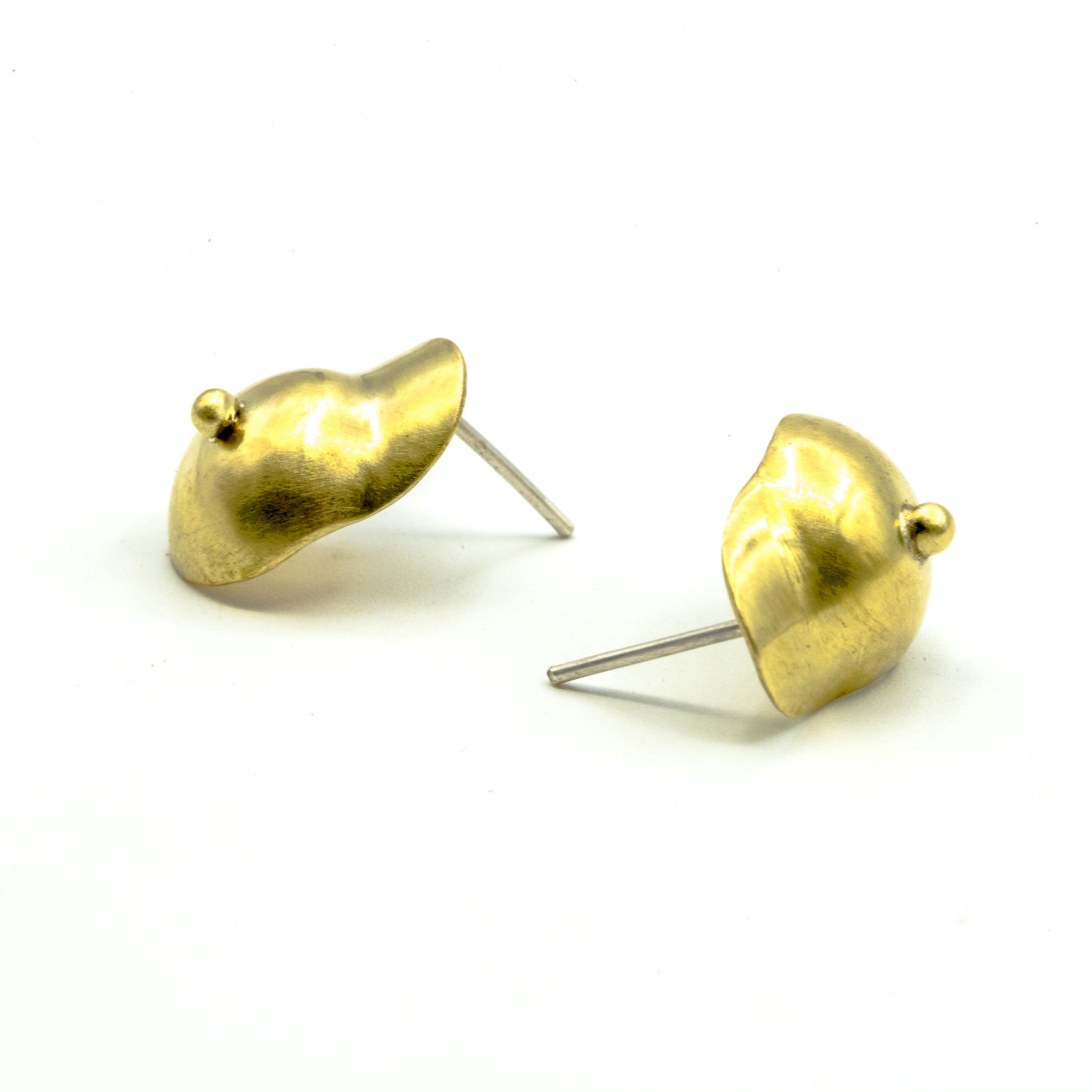boobie shaped brass earrings on which background