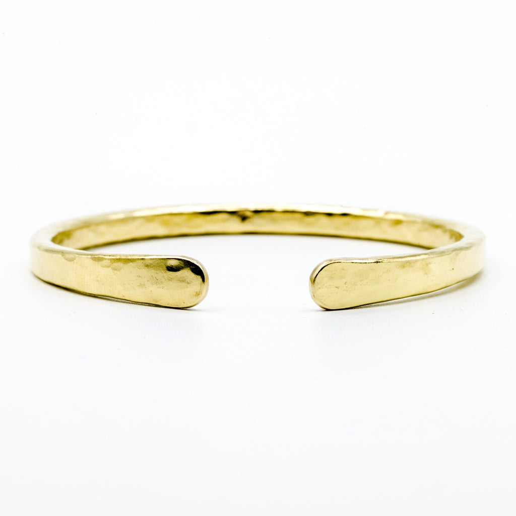 brass hand forged heavy gauge cuff on white background