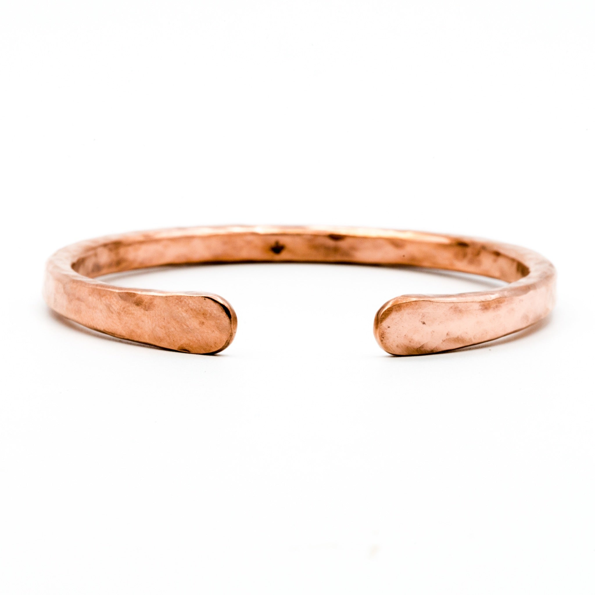 copper hand forged heavy gauge cuff on white background