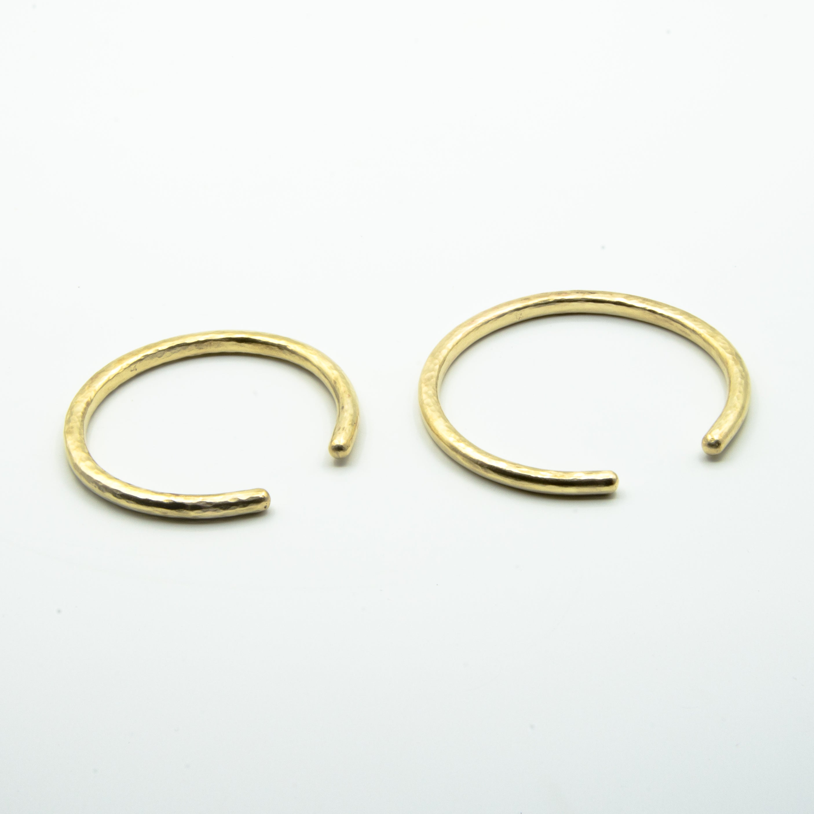 thick brass cuffs front view on white background, sizes small and big