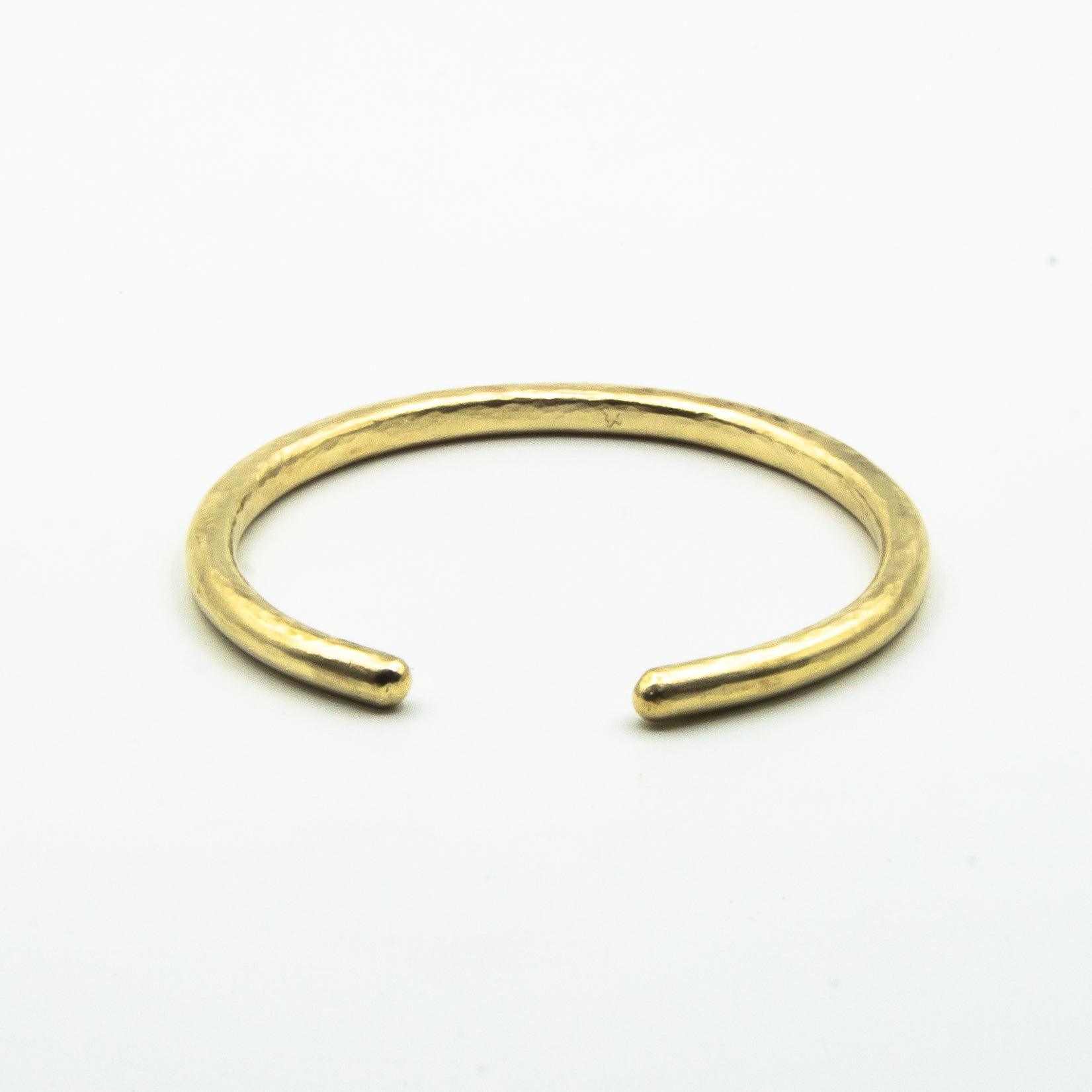 thick brass cuff front view on white background