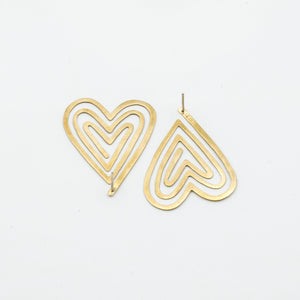 top view of backside of heart shaped stud earrings on white background