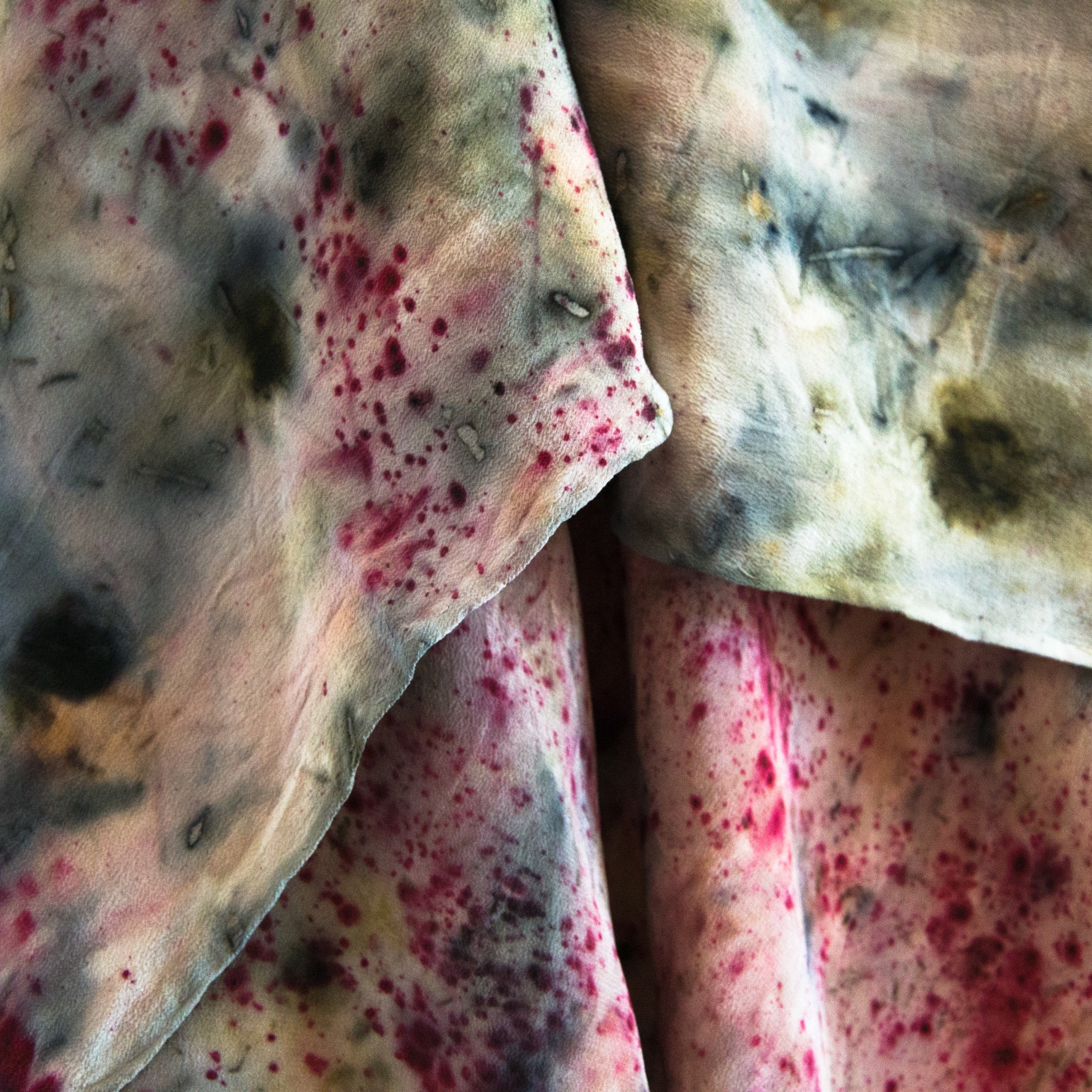 close up silk hand dyed scarf watercolour like blue patterns with pink specks