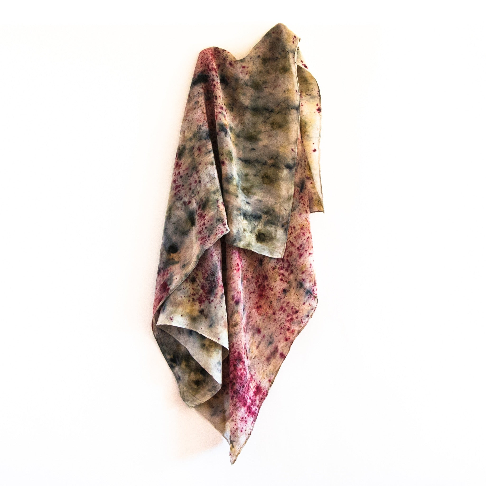 front view of hanging silk scarf with an eco dye pattern