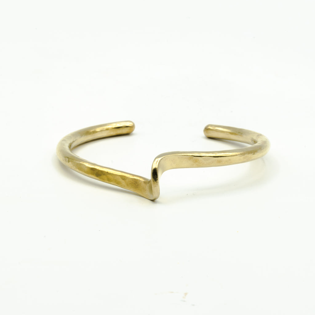 hand forged brass cuff on white background