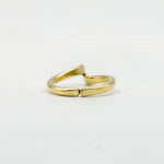 back view of hand forged curved brass ring on white background