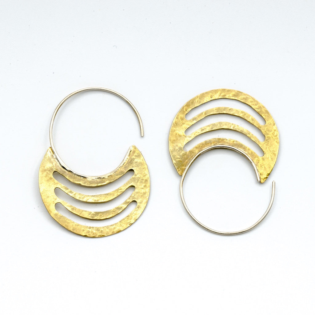 brass sheet earrings with silver hoops on white background