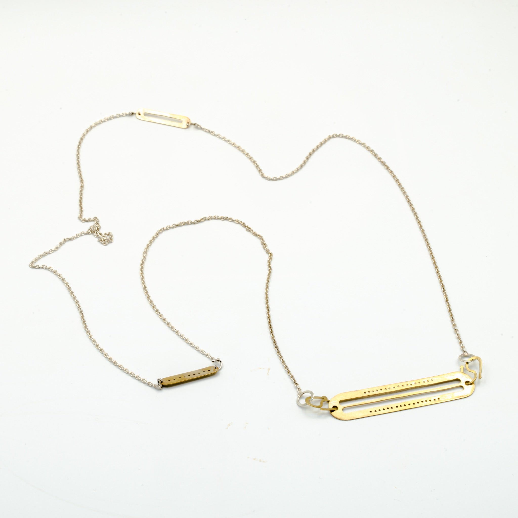 top view of brass cutout pendant necklace