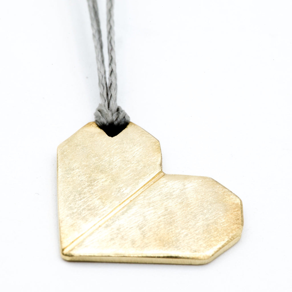 origami heart brass pendant close up