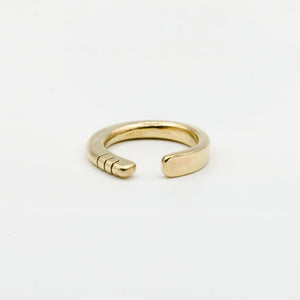 front view of hand forged brass ring with three notches