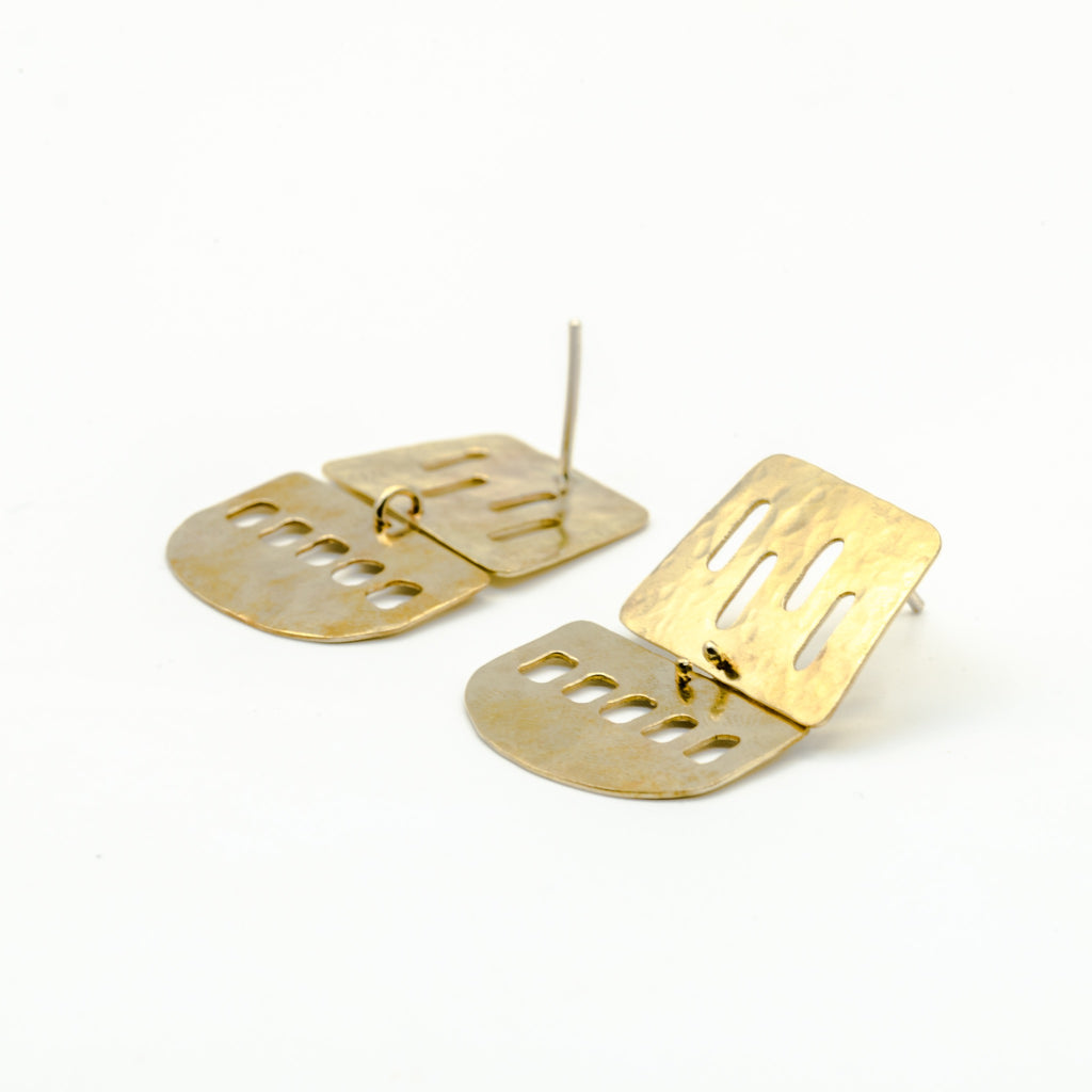 cutout brass sheet dangle earrings on white background