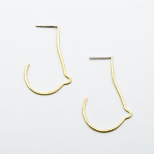 breast shaped brass wire earrings on white background top view