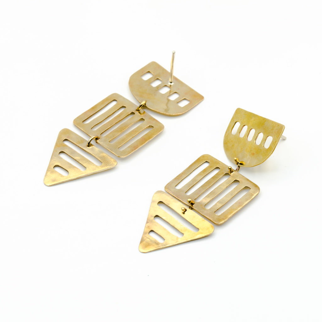 long brass geometric cutout earrings on white background