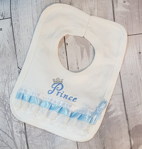baby boys fancy white bib with prince embroidery and lace and ribbons