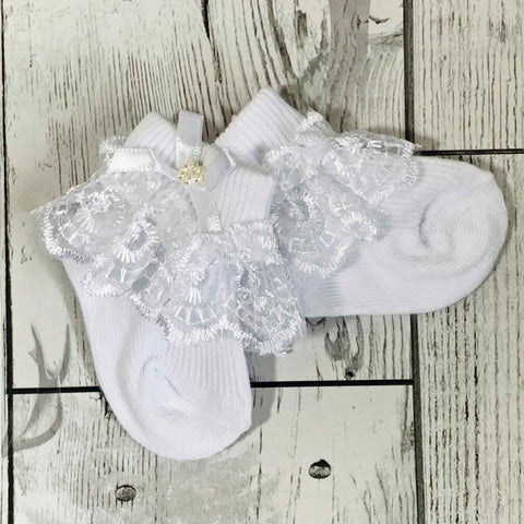 white frilly baby socks