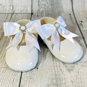 girls white pram shoes with bow