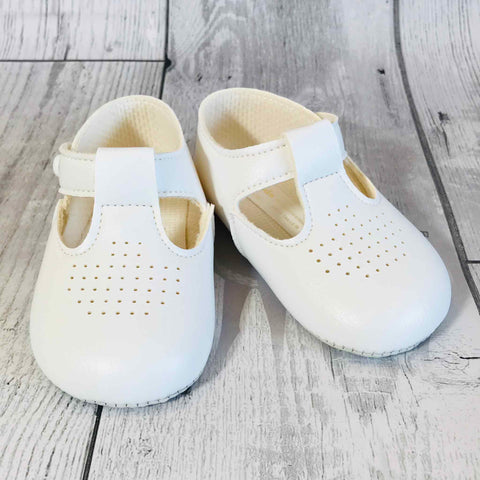 white baby shoes christening