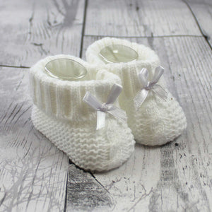 baby knitted boots in white with white bow