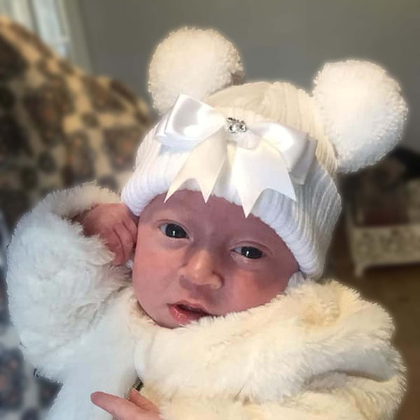 white baby girl double bobble hat