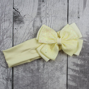 pale yellow headband with sparkly bow