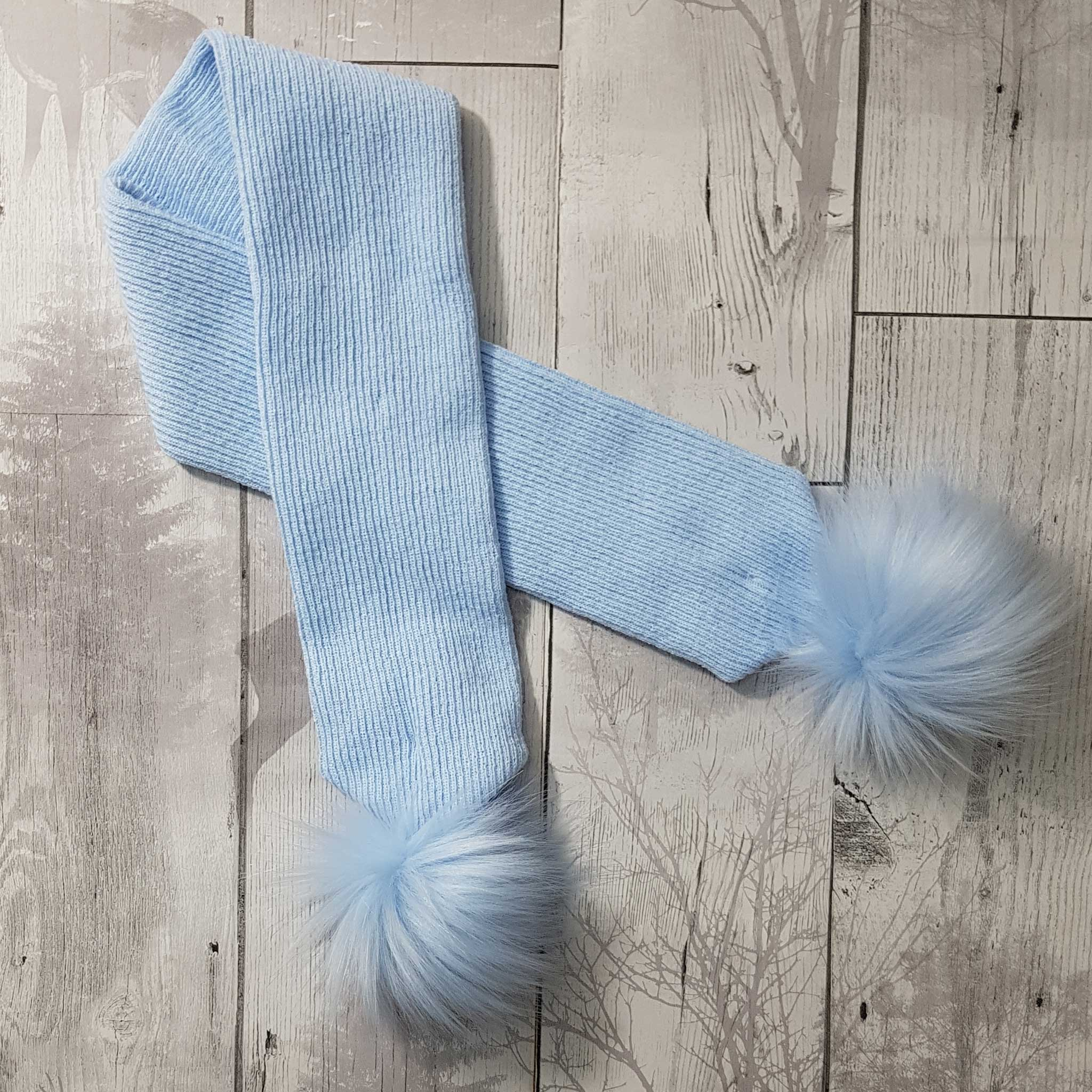 pastel blue baby scarf with blue pom poms