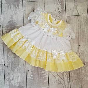 frilly baby dress spanish style yellow