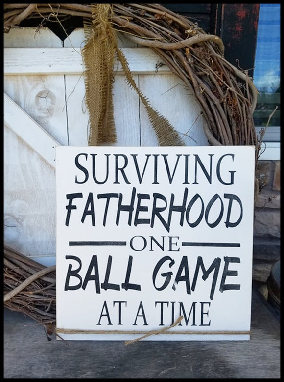 Surviving Fatherhood One Ball Game At A Time