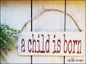 A Child Is Born - Christmas Ornament
