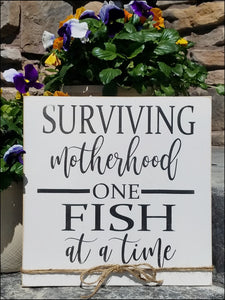 Surviving Motherhood One Fish At A Time
