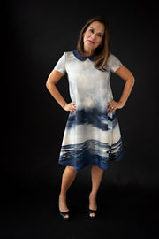 George tent dress sewing pattern. Designed by an independent pattern company. View A with collar and inset sleeves. Sample is made with neoprene with a water motif. Front view.