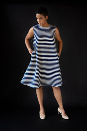 George tent dress sewing pattern. Designed by an independent pattern company. View B is collarless and sleeveless. Sample is made with blue and white striped knit jersey. Front view.