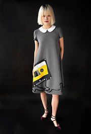 George tent dress sewing pattern. Designed by an independent pattern company. View A with collar and inset sleeves. Sample is made with grey neoprene and includes a hand painted 'mix tape' with ribbon. Front view