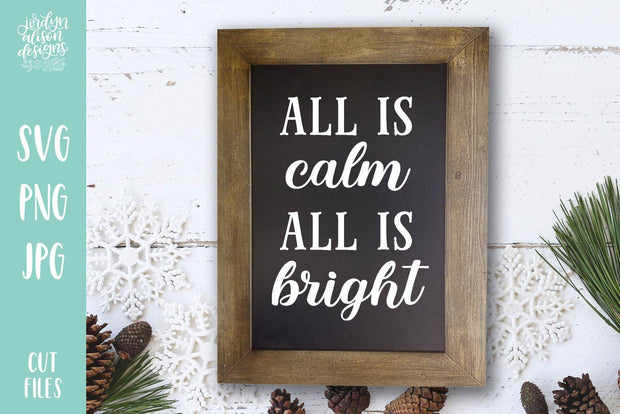 "Rectangle frame with handwritten text in middle ""All is calm, All is bright"""