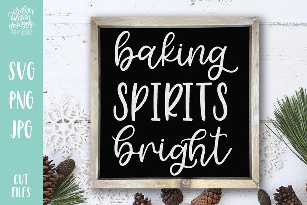 "Square chalkboard frame with handwritten text ""Baking Spirits Bright"""