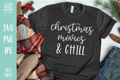 "Grey T-Shirt with Handwritten text ""Christmas Movies and Chill "" in white letters"