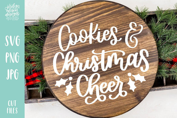"Round wood piece with handwritten text ""Cookies & Christmas Cheer"""