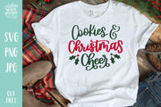 "White T-shirt with handwritten text ""Cookies & Christmas Cheer"""