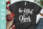 "Grey T-Shirt with Handwritten text ""Be Filled with Cheer"" in white letters"