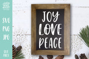 "Rectangle chalkbook frame with handwritten text ""Joy Love Peace"""