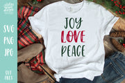 "White T-shirt with handwritten text ""Joy Love Peace"""