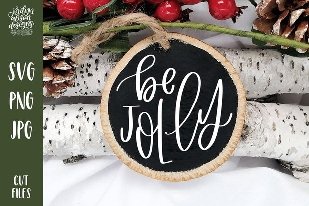 "Handwritten text ""Be Jolly"" on Round Christmas Ornament."