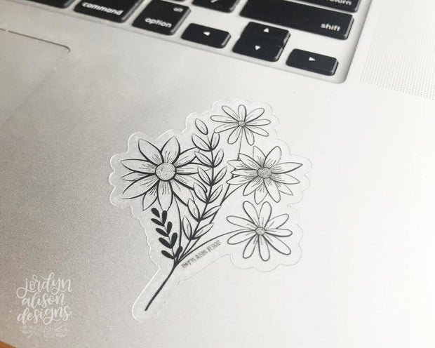 clear floral bundle vinyl sticker on laptop