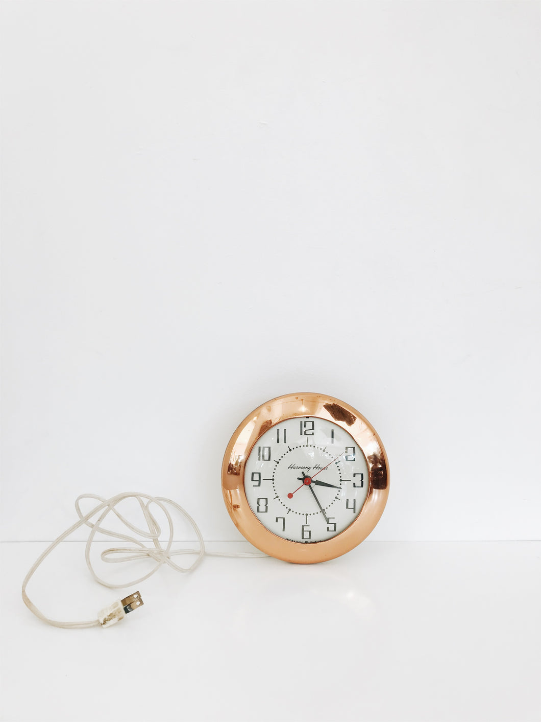 vintage copper electric harmony house clock