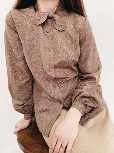 arlee park vintage tan twist-tie button neck blouse with a leaf pattern