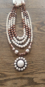 White and copper multi strand necklace with matching earrings