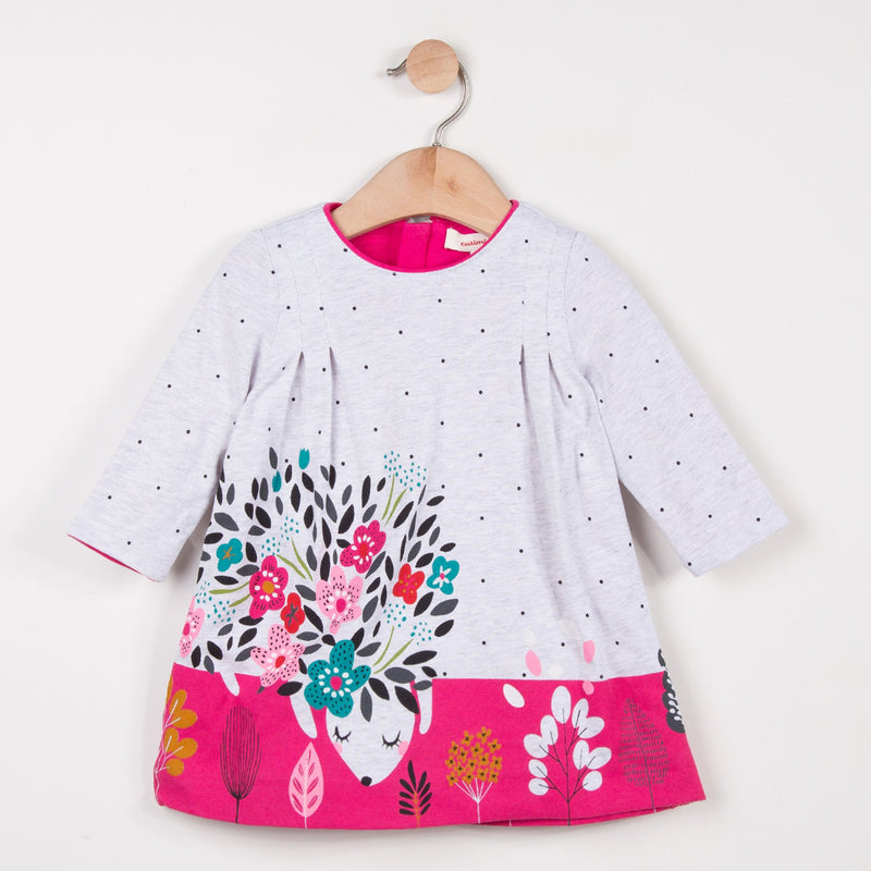 Catimni dress made of soft marl jersey with tiny spots, a small imaginary flowery animal falls asleep. Box pleats on the shoulders. Round neck with pink binding. Printed pattern placed in front and on the bottom. Invisible back zip.
