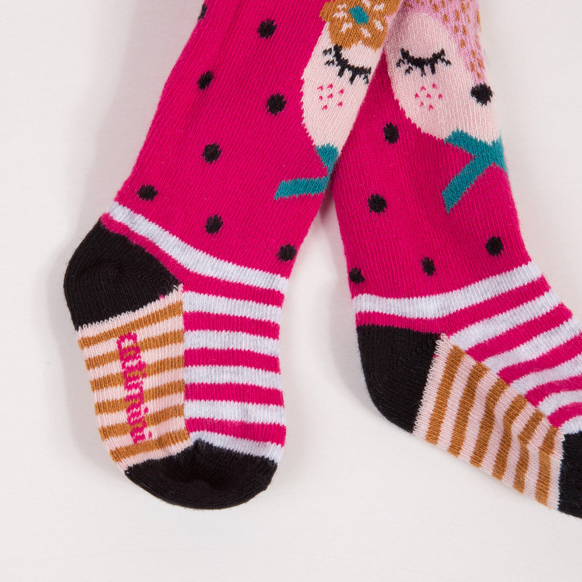 Ultra-soft knitted tights. charming little fawn has quietly fallen asleep on baby's spotted peony pink tights. Catimini design.