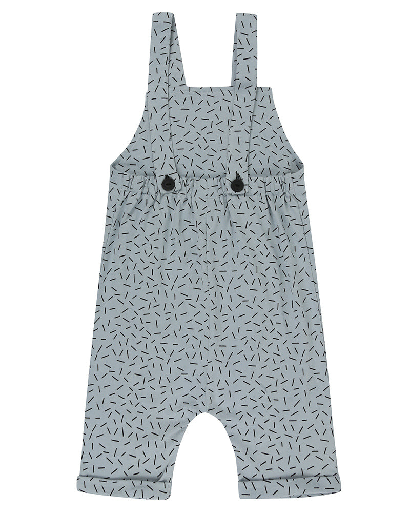 Unisex organic cotton short overalls in blue and white sprinkle print with a striped patch in the front. Shop TurtleDove London now.