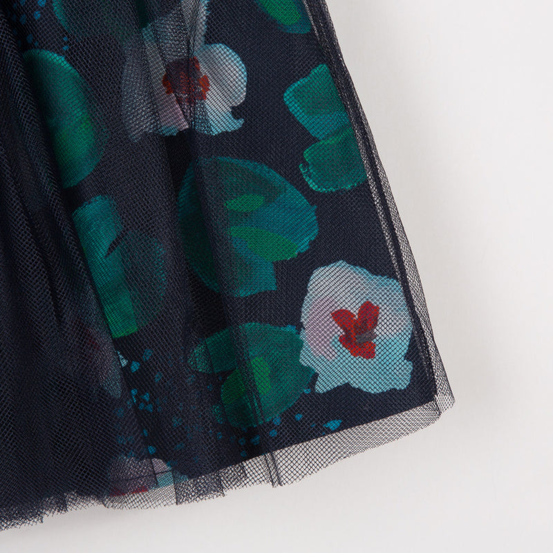 knee-length skirt in tulle on percale printed with flowers for a chic girls' look. Double plain tulle on printed percale. Sequinned elastic waistband. Catimini Label.